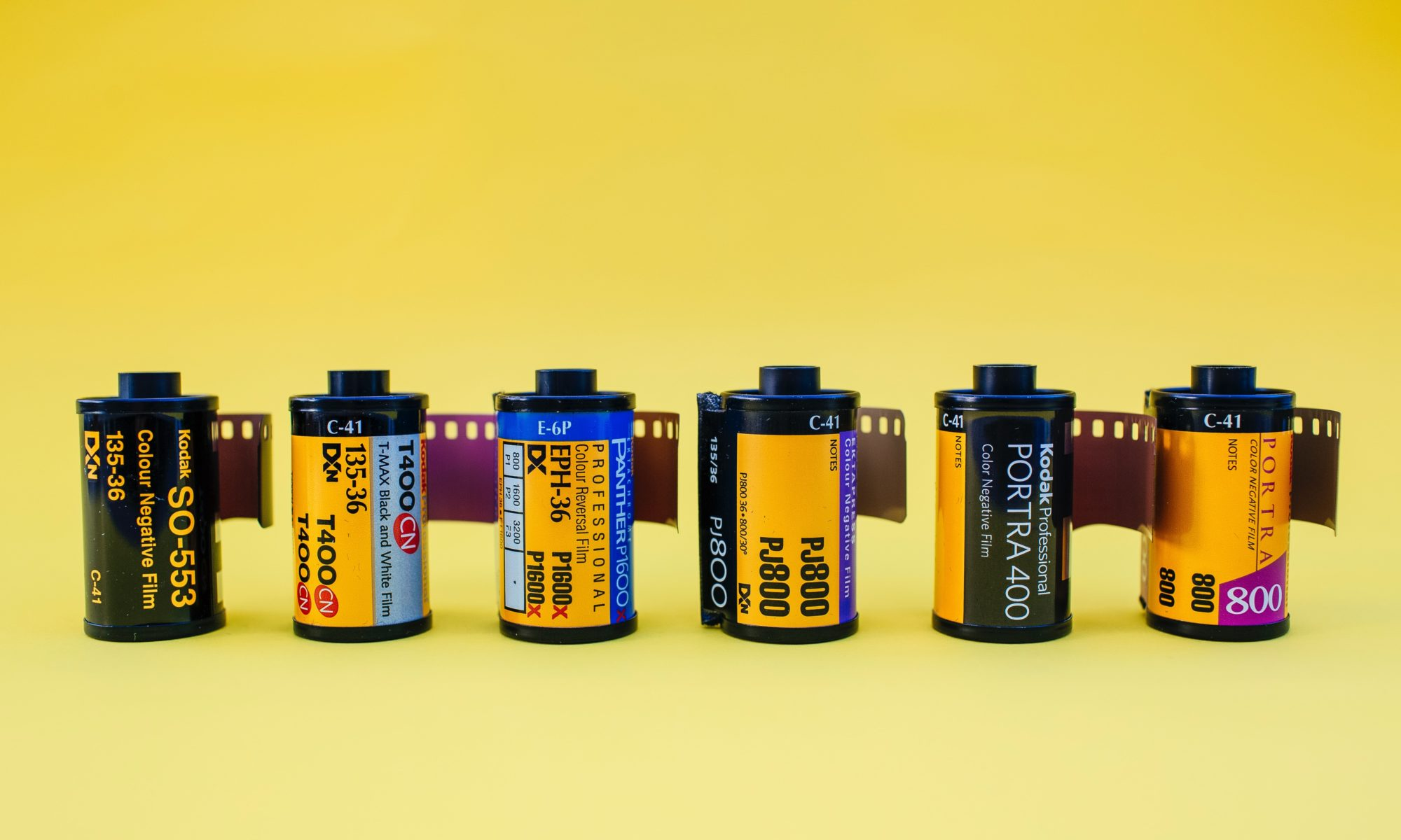 six black and yellow bottles